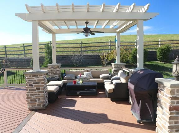 Almond Vinyl Pergola with stone columns and ceiling fan - Chester County PA