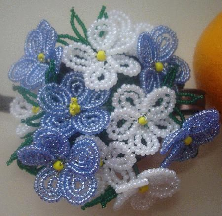 I've made small flowers similar to these.  These have 2-3 rings of beads on the petals.  Really dainty looking