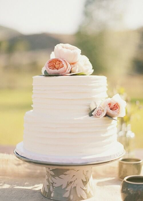 Simple but elegant wedding cake. The few flowers maintain its elegance. More importantly is how it TASTES!