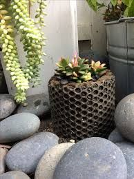 Hypertufa pot created by lining a form with bubble wrap. Then the plastic was burned off with a torch. See more ideas in hypertufa & cement pots @ http://www.containerwatergardens.net/garden-projects-with-hypertufa/