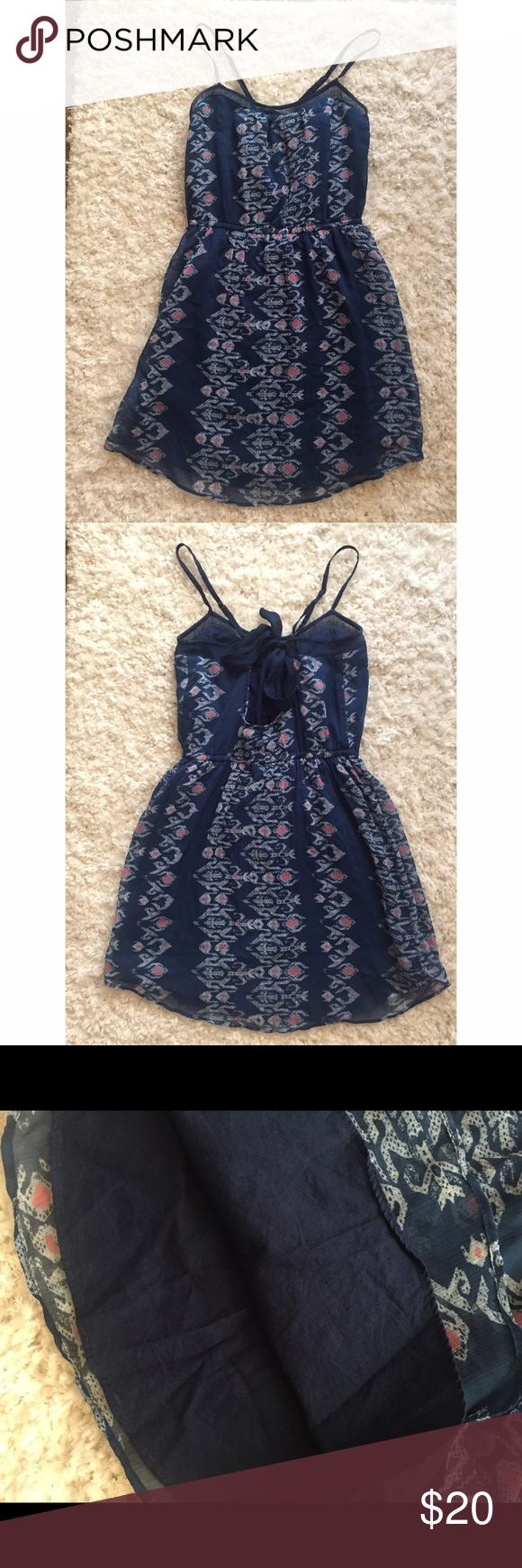 Hollister Dress Patterned navy blue linen dress. Ties in the back, fully LINED. Adjustable straps. Worn ONCE, like new! Excellent condition! Perfect for those Spring/Summer days. Very comfortable! Hollister Dresses