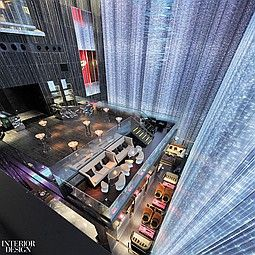 Descending the full 60-foot height of the curtain wall at the W Guangzhou hotel, fiber-optic strands pulse & change color:
