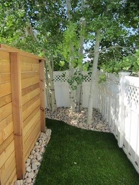 Even better is to designate a bathroom area for your pet. It takes some work, but is possible to train dogs to go in just one or two places in your yard. The ingenious locale shown here is hidden behind a fence. Another option for a bathroom spot is a gravel patch that can easily be hosed down; dogs often prefer gravel to grass anyway.
