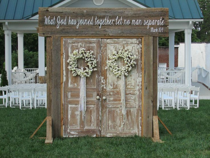Rustic Wedding Doors rent @ Rusted Root Rentals. Amazing entrance setup of wedding doors beautiful entryway for a rustic, outdoor wedding, vintage doors, rustic wedding. vintage wedding. outdoor weddings. wedding ideas. made from old barn wood with verse, what God has joined together let no man separate. Mark 10.9 #rustedrootrentals