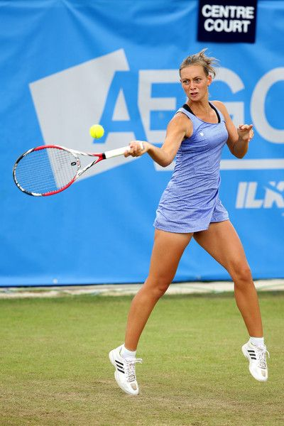 Cindy Burger Photos Photos - Cindy Burger of Netherlands plays a forehand during the Aegon Ilkley Trophy at Ilkley Lawn Tennis