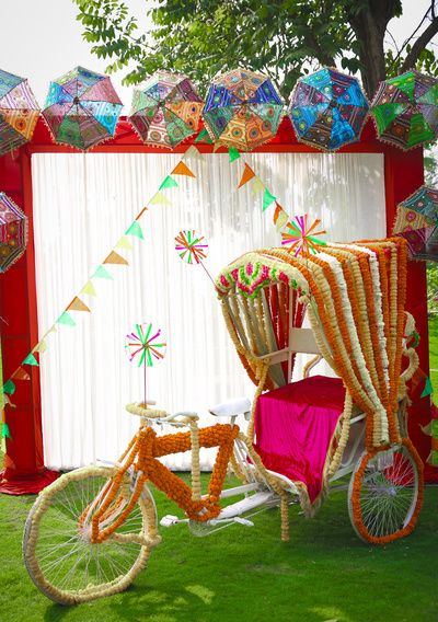 Mehendi Decor - Marigold Flower Decoration | WedMeGood | Rickshaw Decor in Marigold Flower with Umbrella Decor Pannel #wedmegood #indianwedding #mehendidecor #DIY #decor #rickshaw #umbrella