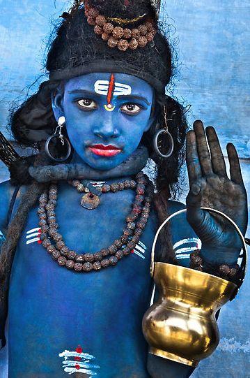 Young boy dressesd as the Hindu god Shiva