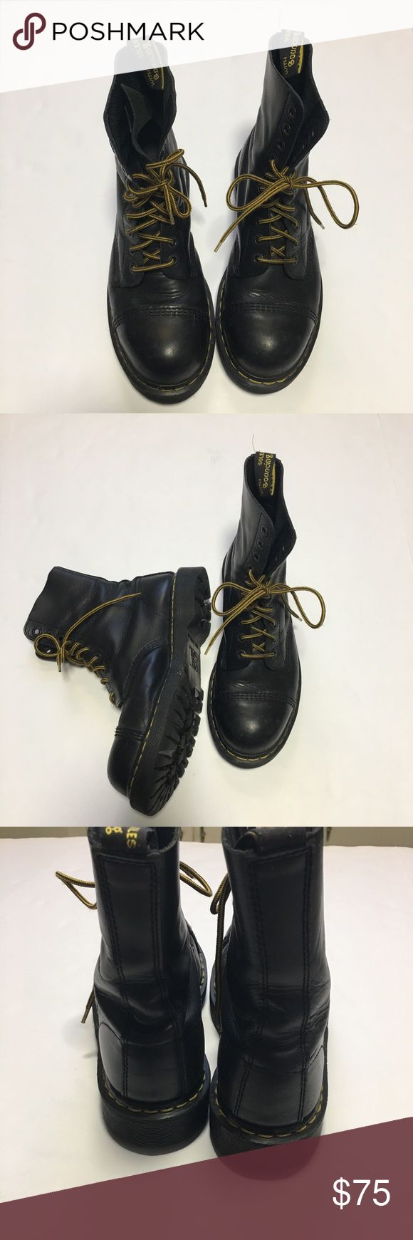 "Dr. Marten Air-Wair Black Steel Toe Boots. SZ 10. Black 8761 Cap Steel Toe Boots by Dr. Marten Air-Wair.  -10 eyelet  -Leather upper & lining -Air Cushioned sole -Traditional lace-up with corded-braid laces & heavy duty eyelets -Trademark ""Air Wair"" heel loop -Extra chunky heel Size tag faded but they are a size 10.  See measurements but note sole extends actual shoe by approximately 3/8"" all around making them about 11 1/8"" = just over 28cm.  DM size chart also shows this a US 10.  Great…"