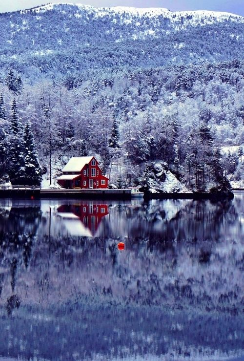 Snowy cabin on a remote lake