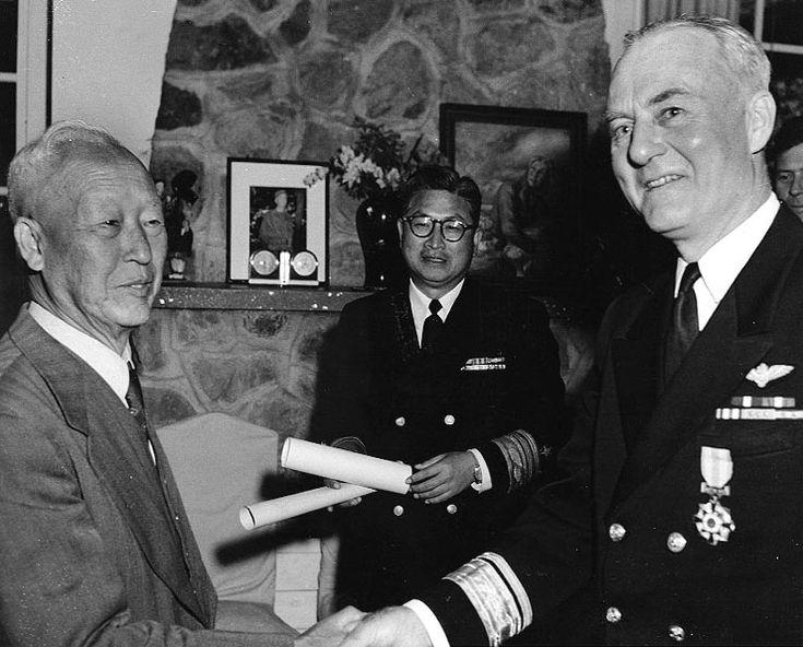 Syngman Rhee awarding a medal to U.S. Navy Rear Admiral Ralph A. Ofstie during the Korean War in 1952