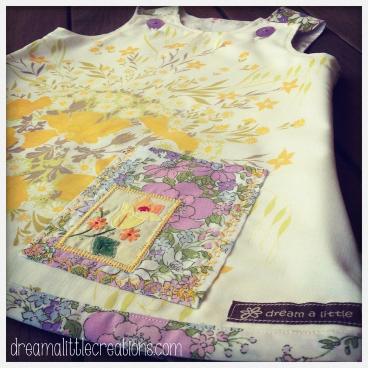 Vintage fabric pinny dress, with embroidered flower pocket!