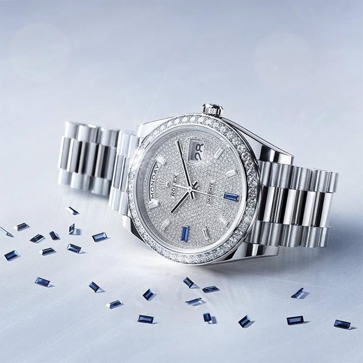 57e6ee16eb4 The Rolex Day-Date 40 in 18ct white gold with diamond-paved dial and  gem-set bezel completed by baguette-cut diamonds and sapphires.