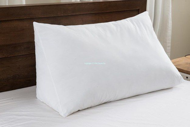 This super soft, wedge-shaped pillow that provides extra support for reading in bed. | 21 Mother's Day Gifts For Moms Who Love To Read