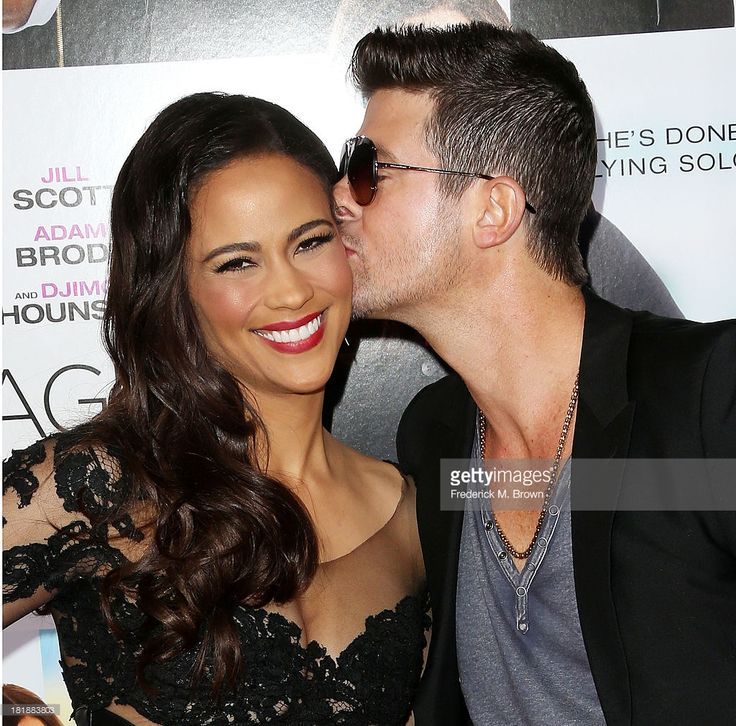 Actress Paula Patton (L) and recording artist Robin Thicke attend the premiere of Fox Searchlight Pictures' 'Baggage Claim' at the Regal Cinemas L.A. Live on September 25, 2013 in Los Angeles, California.
