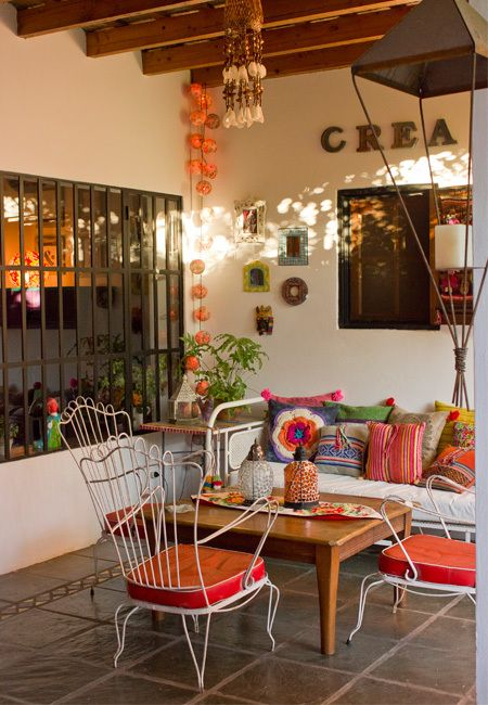 Indoor/outdoor living room idea. Metal frame furniture with weather resistant cushions