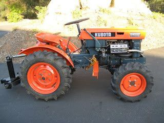 Very much like my old Kubota tractor in Santa Barbara. Mine had front loader, chipper, ripper, 6 ft. Wood's mower. 4wd diesel
