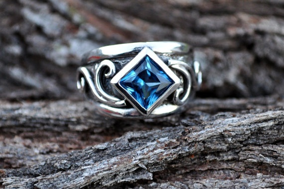 Feminine sterling silver ring with bright blue CZ by SusanRoos