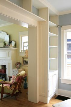 Bookcase surrounding a door - Could we do this to separate the living room/dining room once we expand?