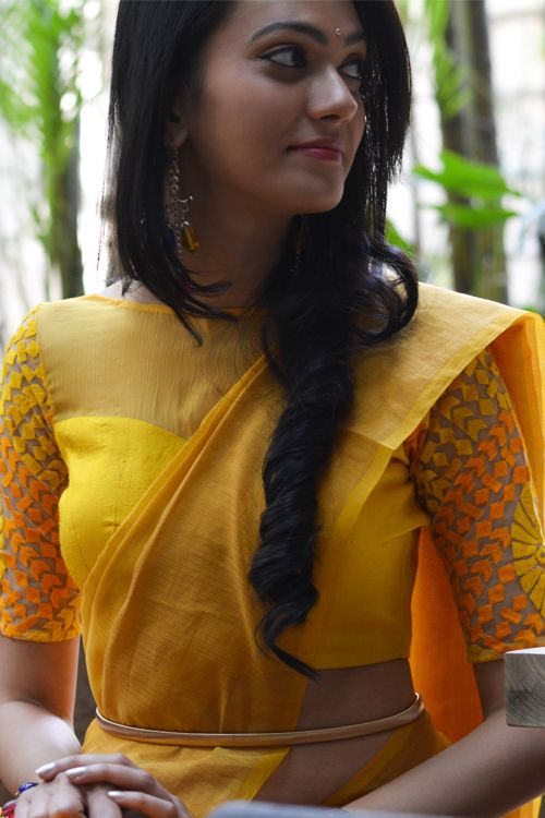 Classic yet quirky, a sunshine yellow blouse which combines three fabrics in the same colour   FABRIC:  Body - Yellow raw silk  Yoke - Yellow chiffon  Sleeves - Yellow & orange threadwork on beige net    CARE: Dryclean only