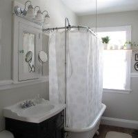 Lovely Shower Curtain Rod decorating ideas for Stunning Bathroom Eclectic design ideas with bunting claw foot tub cosmetics mirror extension mirror freestanding bathtub gray grey