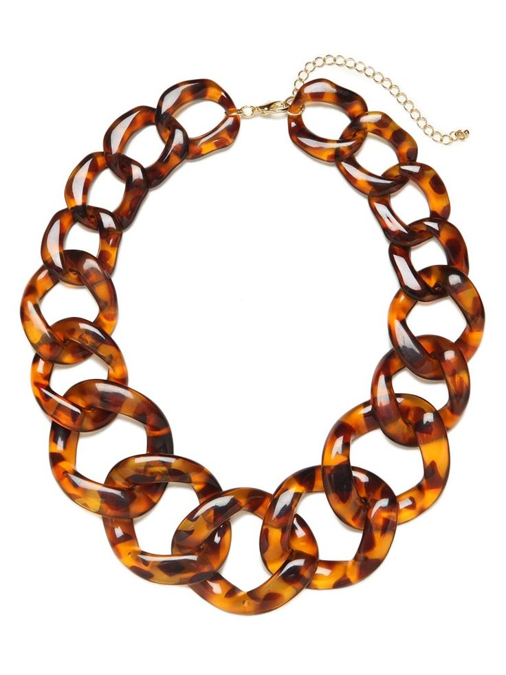 Indulge in the tony, Uptown allure of this stunning statement necklace. It features chunky tortoiseshell links for a look thats Jackie O-glamorous.