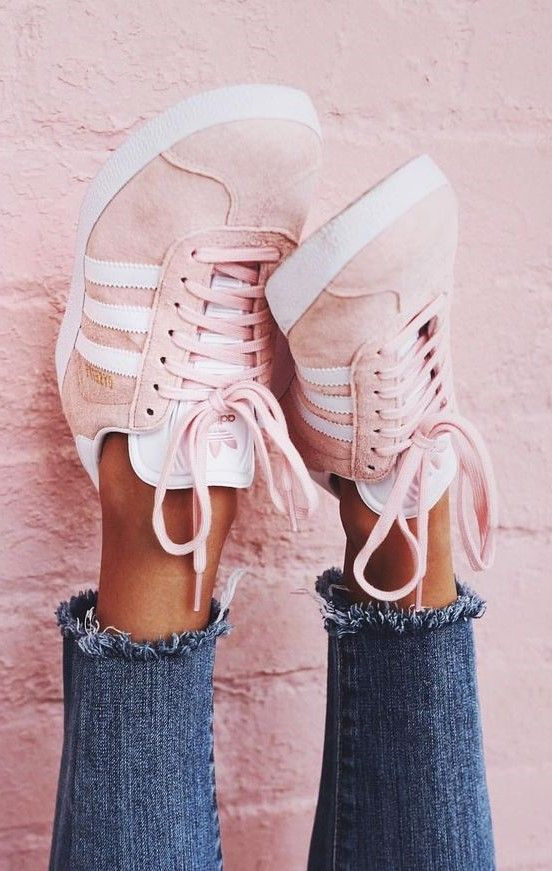 A classic indoor soccer shoe gets a modern rendition in the adidas Pink Gazelle Sneakers. These women's sneakers are defined by a pigskin leather upper that lends a smooth, suede feel, a light pink wash, thick rubber sole and serrated 3-Stripes at the sides. #Adidas