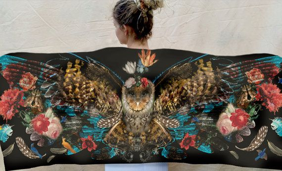 A stunning owl wing scarf in natural tones with a mixture of bird feathers and flowers in this unique design of Frida the wise owl. Spread your