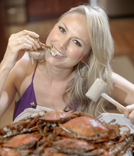 """Stacy Keibler, actress and model. """"I've been to so many different places here to eat crabs. We've gone to  Costas a lot   Just recently I went down to Canton Dockside, which was amazing. My parents and I will pick up a bushel from a little stand on the side of the road and steam our own. Eating crabs is something that I do every single time I come home. Even if it's in and out in a day, I literally will go straight from the airport to get crabs."""