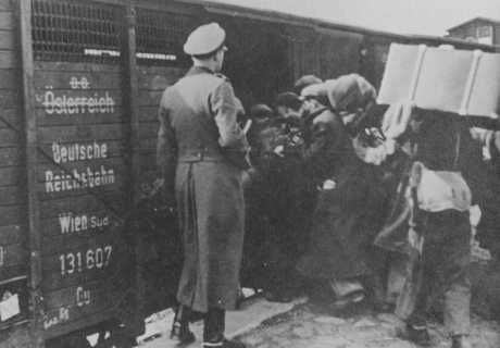 Jews are forced into boxcars destined for the Belzec extermination camp. Lublin, Poland, 1942.