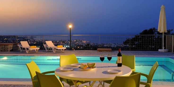 Sea and city view with Cretan wine by the pool at Trever Villa, Heraklion, Crete