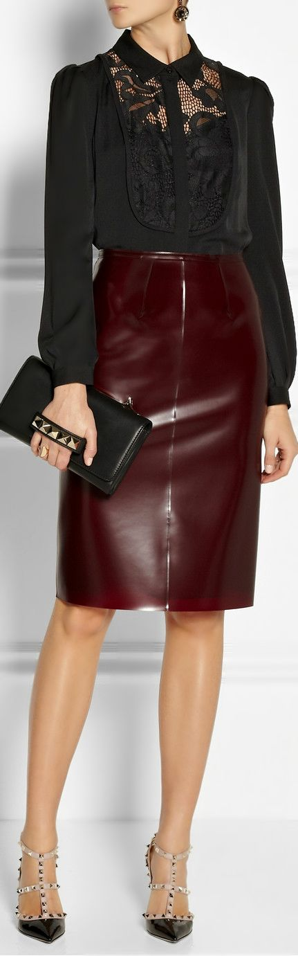 Burberry innovates with a blood red / wine colored latex skirt.