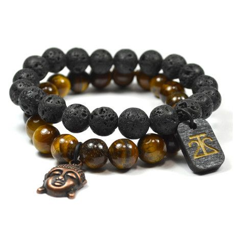 This two-piece Tiger Eye and Lava Rock set features two bracelets made with handsome, all-natural beads. With one in Tiger Eye, one in Lava Rock, and both accented with Buddha charms, you can mix and match to your liking. Product Details — 2 Bracelets — 10mm Beads — Tiger Eye and Lava Rocks