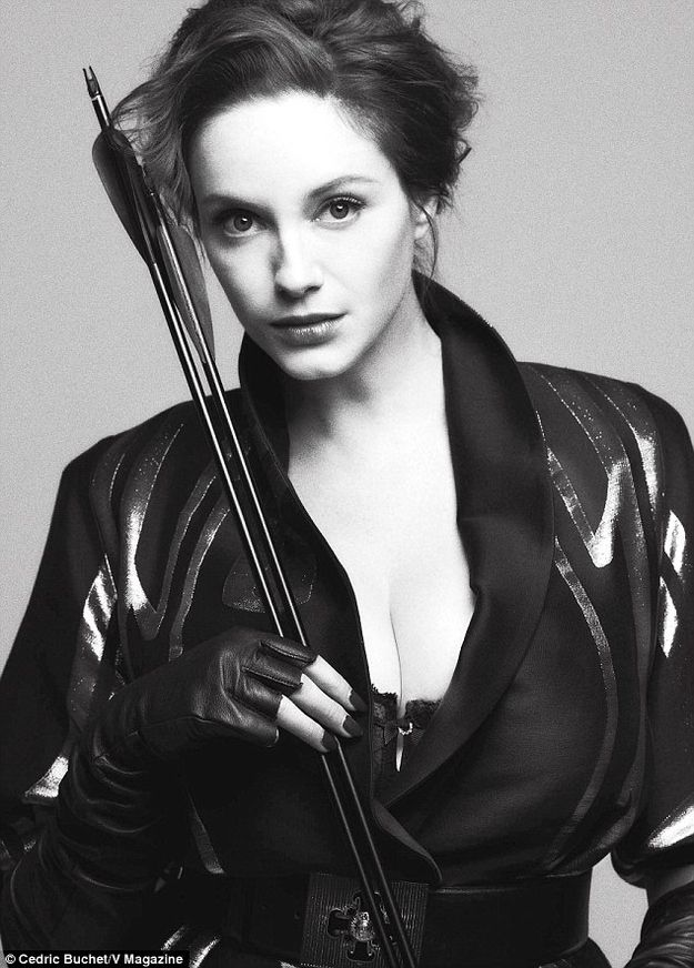Christina Hendricks Dressed In Leather, Posing With Weapons. Hunger Games inspired perhaps?