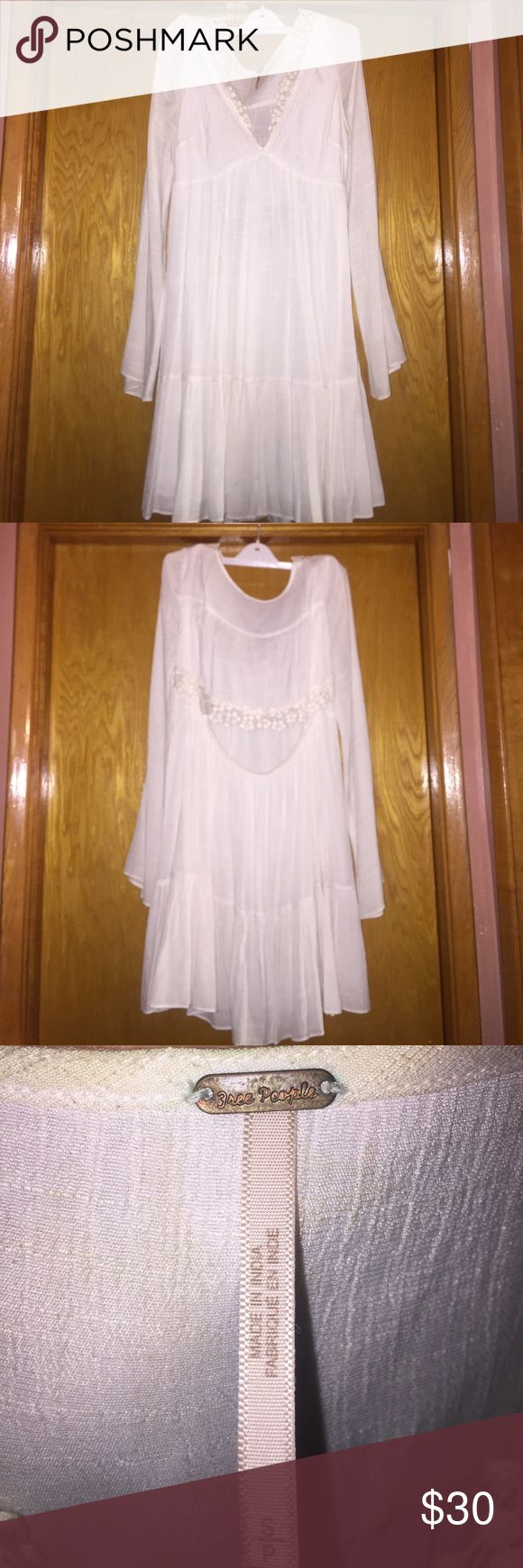 """Free People white festival dress Free People white dress. Slight bell sleeves. Open back slit. Lace trim. Size S Length shoulder to bottom 33.5"""" EUC ONLY WORN ONCE. Free People Dresses Midi"""