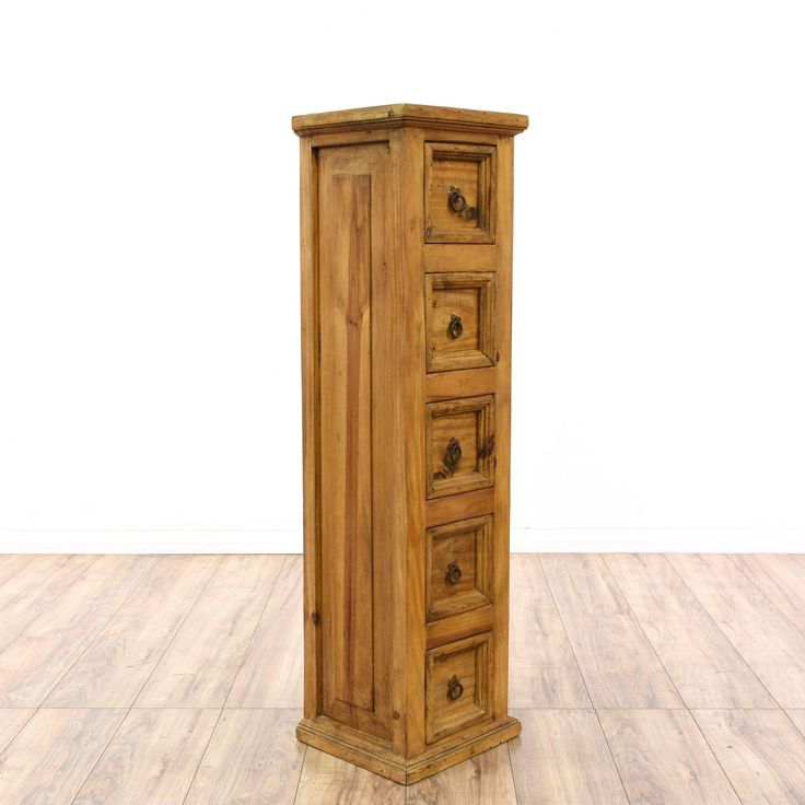 This rustic chest of drawers is featured in a solid wood with a raw pine finish. This tall narrow dresser has 5 small drawers, simple carved trim and metal hardware. Perfect for a small space! #countryfarmhouse #dressers #talldresser #sandiegovintage #vintagefurniture