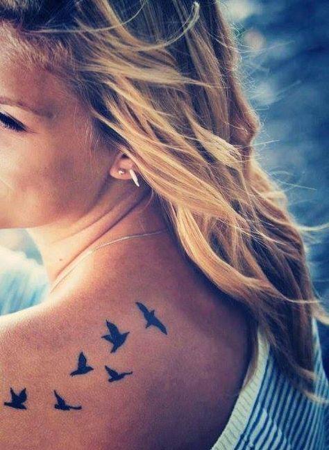 Little back tattoo of flying birds. More