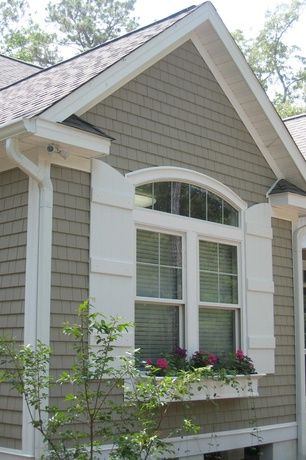Cottage Exterior of Home with Arched window and Country French shutters. I love this with the window box.