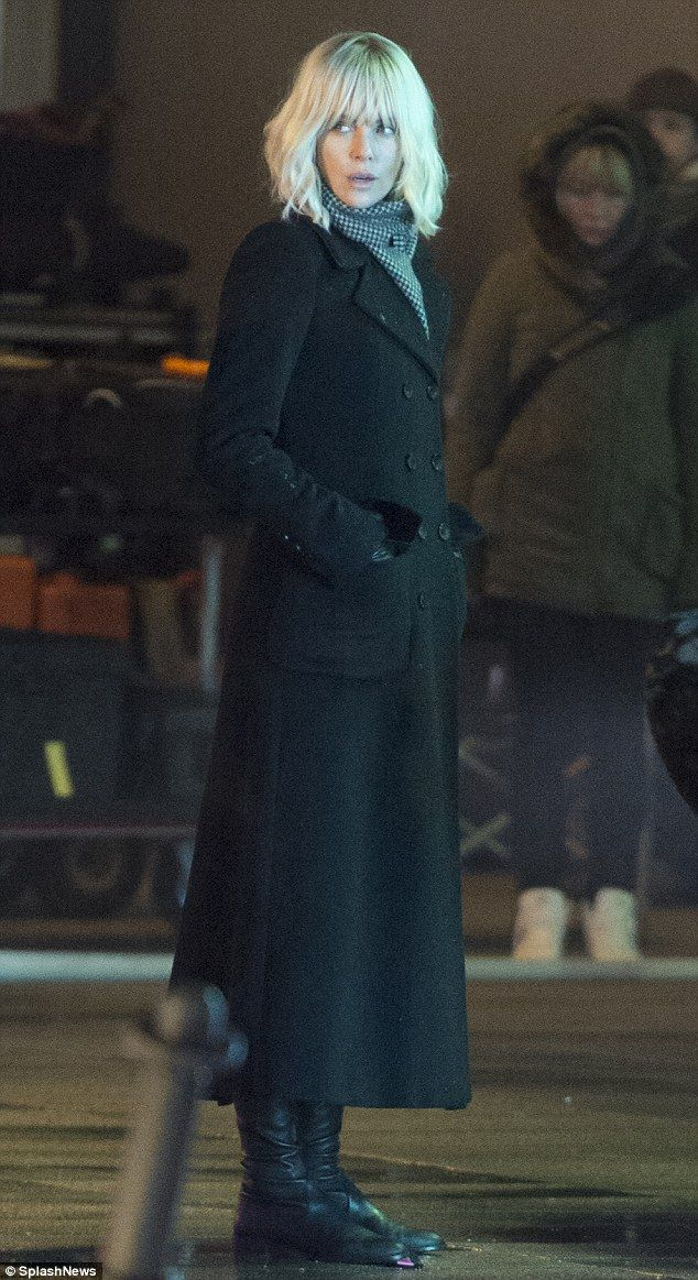 All change: Charlize was wearing a platinum blonde wig on location on Tuesday