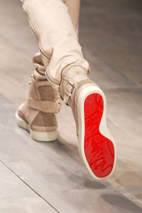 Off white side seam zip pants paired with red soled high tops with straping detail.