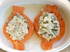 Copycat Costco crab & shrimp stuffed salmon. Baked with a hint of wine & topped with a mayo & Sriracha sauce, it is amazing!