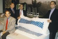 Paramount executives Richard Diamonstein, left, Richard Fleck, Arthur Diamonstein and Jamie Diamonstein display a layer of Pure Gel on a new latex and gel bedding line.  Featured in the May 6, 2013, Issue of Furniture Today.