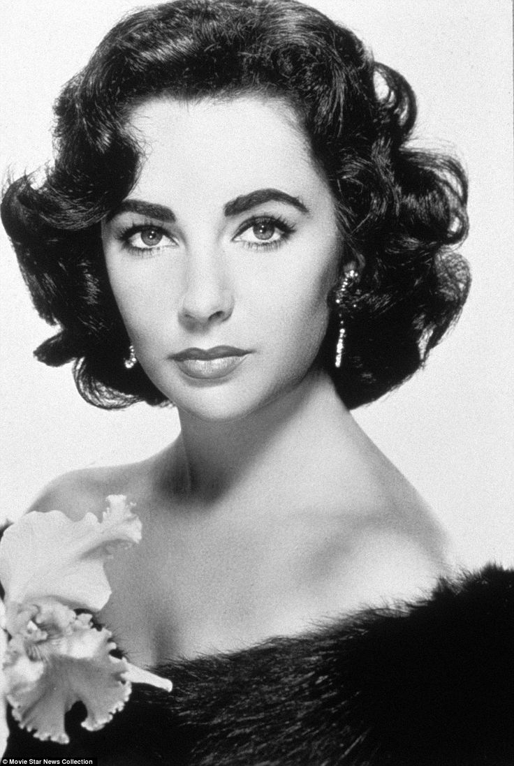 Dame Taylor: The stunning Elizabeth Taylor poses for a close up glamor shot