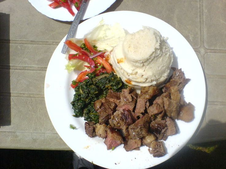 Nyama Choma (Grilled beef) and Ugali (maize meal porridge) with stewed ...