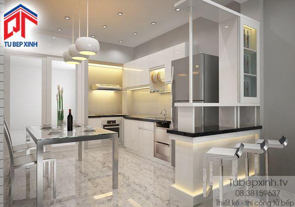 Tu bep - mẫu tủ bếp TB021G.  Tủ bếp được thiết kế hình L cùng quầy bar đẹp mắt, sang trọng. Tông màu chủ yếu được lựa chọn đồng bộ màu trắng tạo nên sự tao nhã hài hòa cùng với thiết kế của ngôi nhà.