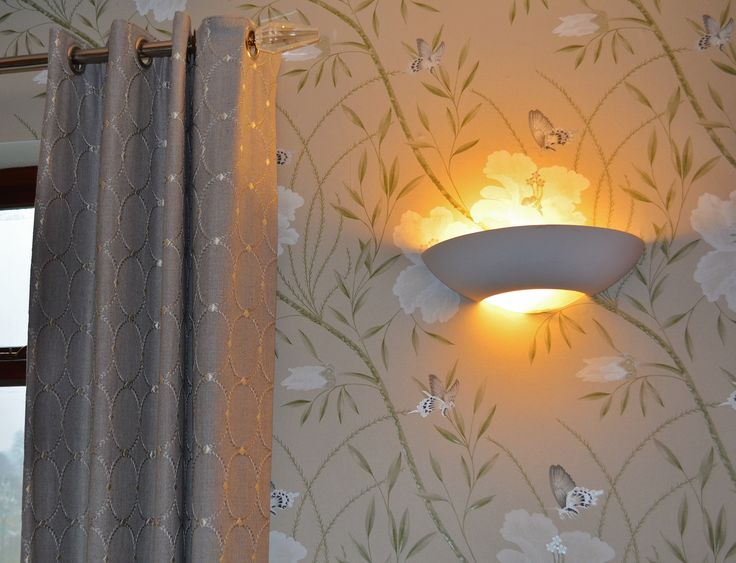 Elegant wallpaper coordinated with handmade curtains and finished off with curtain hardware to complete the look