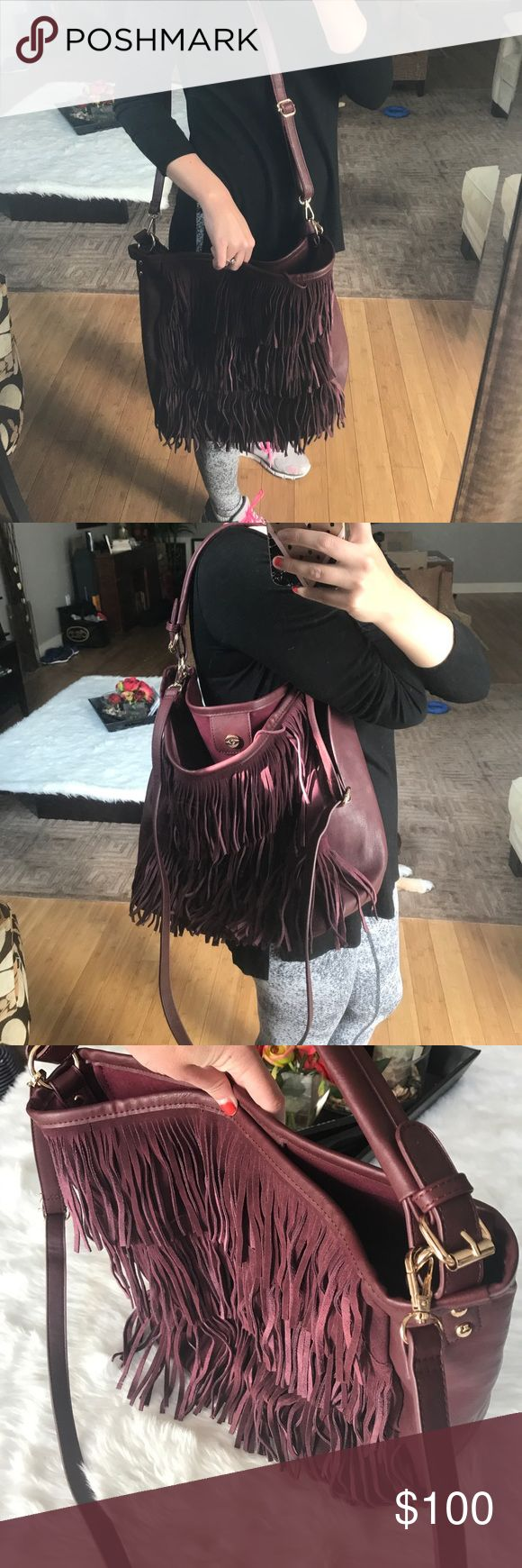 Asos fringe front hobo with strap This maroon Fringe Hobo is a beautiful shade and in excellent condition.  Come with detachable shoulder strap.  Minor signs of wear on inside. Outside and bottom look clean.  MAKE AN OFFER Asos Bags Hobos