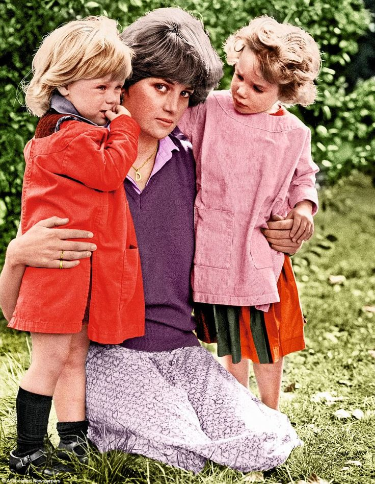 At the Young England Kindergarten in Pimlico. This was the nursery where the then Lady Diana was working three days a week as a teaching assistant when the romance with Charles began. This picture with two of her charges was taken in September 1980 just after news of the romance had broken. Diana is wearing the see-through skirt that famously revealed her long legs