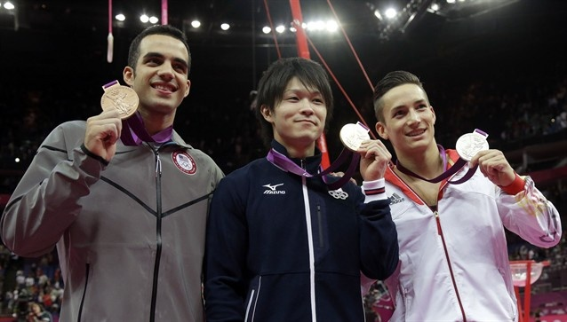 Great finish for the bronze for Danell!  Danell Leyva (USA), left, Japanese gold medallist Kohei Uchimura, center, and German silver medallist Marcel Nyugen pose for photographers with their bling.