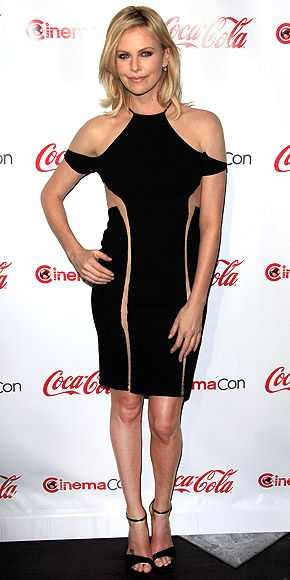 CHARLIZE THERON: CinemaCon's award recipient edges out the competition in an eye-catching LBD with peekaboo lines and sexy sandals in Las Vegas.: Hot Dress