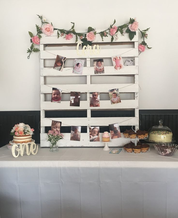 Floral first birthday. Pallet with pictures and flowers. Chantilly cake. Naked cake.